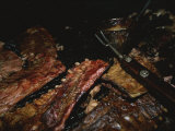 Close View of Ribs Barbecuing Photographic Print by Medford Taylor