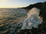 Surf Pounds on a Rocky Coastline at Sunset Photographic Print by Steve Winter
