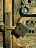A Doorway with an Ornately Carved Latch and Window Photographic Print by Ed George