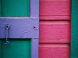 A Colorful Door Painted in Pastel Colors Photographic Print by Raul Touzon