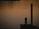 Lovers in an Embrace at Sunset on a Pier over Victoria Harbour Photographic Print by Todd Gipstein
