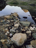 A Rocky Shore and Reflections on Water in the San Juan Mountains Photographic Print by Bill Hatcher