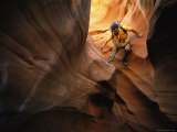 Canyoneering in Water Holes Canyon in Arizonas Slot Canyon Region Photographic Print by Bill Hatcher