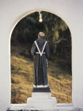 A Statue of a Monk Inside an Arch Photographic Print by David Evans