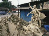 Statues of Kali Line a Road in Ledo Photographic Print by Maria Stenzel