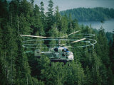 The Swirling Blades of a Helicopter Used for Logging Fill the Air Photographic Print by Joel Sartore