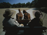 A Carriage Pulled by Two Horses Approaches a Fork in the Road Photographic Print by Michael Melford