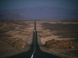 Power Towers Line the Pan-American Highway in the Atacama Desert Photographic Print by Joel Sartore