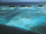 Shallow Water Surrounds a Cluster of Small Pacific Islands Photographic Print by Tim Laman