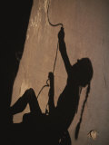 The Shadow of a Rock Climber on a San Rafael Cliffside Photographie par John Burcham