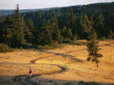 A Woman Runs Along a Hilltop Trail Photographic Print by Skip Brown