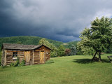 Storm Clouds Form Above a Log Cabin on the Site of French Azilum Photographic Print by Raymond Gehman