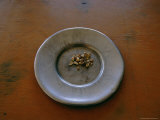 A Ceramic Plate with Nuggets Sitting on a Wooden Table Photographic Print by Maria Stenzel