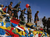 Pilgrims Celebrate Losar with Prayer Flags and Prayer Papers Photographic Print by Maria Stenzel