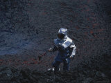 A Scientist in Full Thermal Suit and Helmet Gathers Lava Samples Photographic Print by Peter Carsten