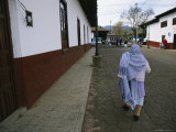 A Mexican Woman Walking Down the Street, One of the Oldest Towns on the Lago (Lake) De Pazcuaro Photographic Print by Gina Martin
