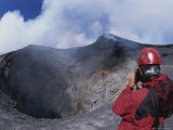 A Scientist is Seen Photographing a Crater on Mount Etna Photographic Print by Carsten Peter