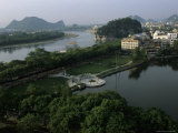 Lake with Park and Elephant Trunk Hill, Guilin, Guangxi, China Photographic Print by Raymond Gehman