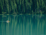 Canoeing on Still Water of Yoho National Parks Emerald Lake Photographic Print by Michael Melford