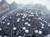 Men gather in the snow for the Landsgemeinde, the annual vote. Lmina fotogrfica por Cotton Coulson