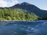 A Mountain Peak Looms over the Aqua Water of the Futaleufu River Photographic Print by Skip Brown