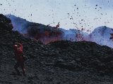 A Man Shields His Face from Falling Lava Bombs on Mount Etna Photographic Print by Peter Carsten