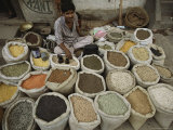A Nepalese Vendor Sitting Among Sacks of a Variety of Legumes Photographic Print by Tim Laman