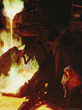 A Man in Protective Gear Tends a Smelter at Magma Metals Company Photographic Print by Joel Sartore