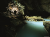 A Scientist Silhouettted Beneath a Skylight in Cueva De Villa Luz Photographic Print by Stephen Alvarez