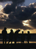 Silhouetted Fishermen on the Shore at Twilight Photographic Print by Jason Edwards