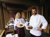 The Emerald Lake Lodge Chef and a Waitress Display Plates of Food Photographic Print by Michael Melford