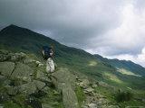 A Hiker Gazes Towards Ben Nevis Photographic Print by Joel Sartore