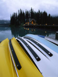 A Row of Canoes on an Emerald Lake Dock Photographic Print by Michael Melford