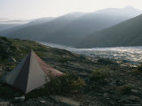 A Mountain Campsite with a Tent Set up Near a Glacier Photographic Print by Tim Laman