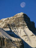 Daytime View of the Moon Above Mount Rundle in Canadas Rocky Mountains Photographic Print by Mark Cosslett