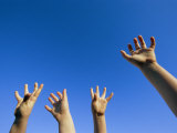Childrens Hands Reach Toward the Blue Sky Photographic Print by Joel Sartore