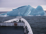 A Ship Approaching an Unusual Deep Blue Iceberg in Antarctic Sound Photographic Print by Gordon Wiltsie