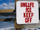 A Sign Warns That the Lake Has Frozen over with Unpredictable Ice Photographic Print by Stephen St. John