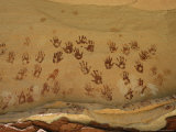 Ancient Indian Handprints Decorate a Sandstone Wall Photographic Print by Ira Block