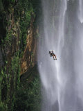 Climber Dangles on Rope Near a Waterfall in Nordeste, Brazil Photographic Print by Mark Cosslett