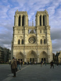 Tourists Mill About in Front of Notre Dame Cathedral Photographic Print by Charles Kogod