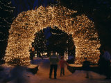 An Arch Built of Antlers is Covered in Lights at the Town Square Photographic Print by Jim Webb