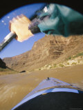 Cliffs Viewed Between the Outstretched Arm of a Kayaker and the Bow Photographic Print by Mark Cosslett