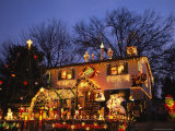 A Home is Covered with Colored Christmas Lights Photographic Print by Joel Sartore
