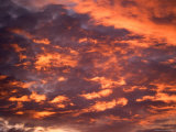 Blazing Cloud-Filled Sky at Sunset Photographic Print by Raul Touzon