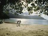 People Frolic on a Man O War Bay Beach Photographic Print by Ed George
