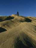 Cyclist Riding over Slick Rock in Oregon Basin Photographic Print by Bobby Model