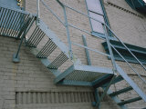 Blue Fire Escape on a Building in Milwaukees Third Ward District Photographic Print by Paul Damien