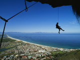 Rock Climber Dangles from a Rope above Cape Town Photographic Print by Bill Hatcher