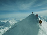 Mountain Climbers Hike along a Ridge to a Mountaintop Photographic Print by Bill Hatcher